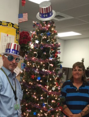 The Transportation Routing Dept Holiday Tree goes all out to honor those who we have lost fighting for our freedoms, our independence, and our American Work Force!