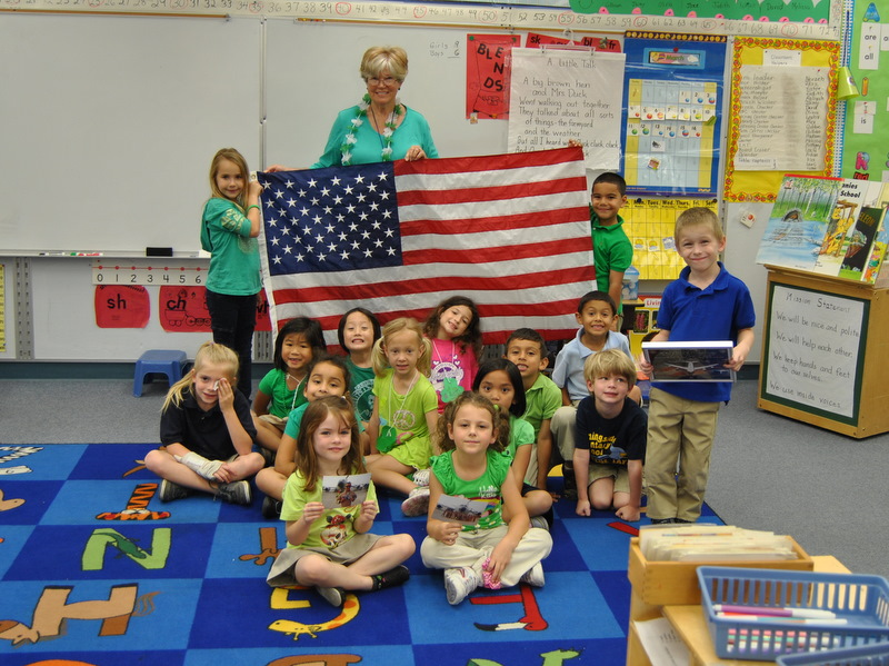 Morningside Elementary kindergarten class receives flag from captain
