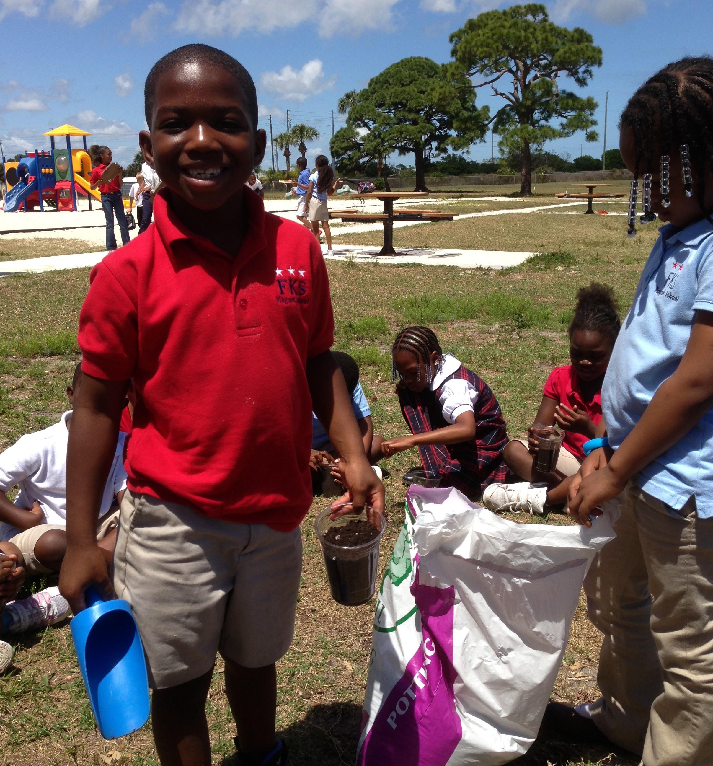 F. K. Sweet kindergartners watch their garden grow