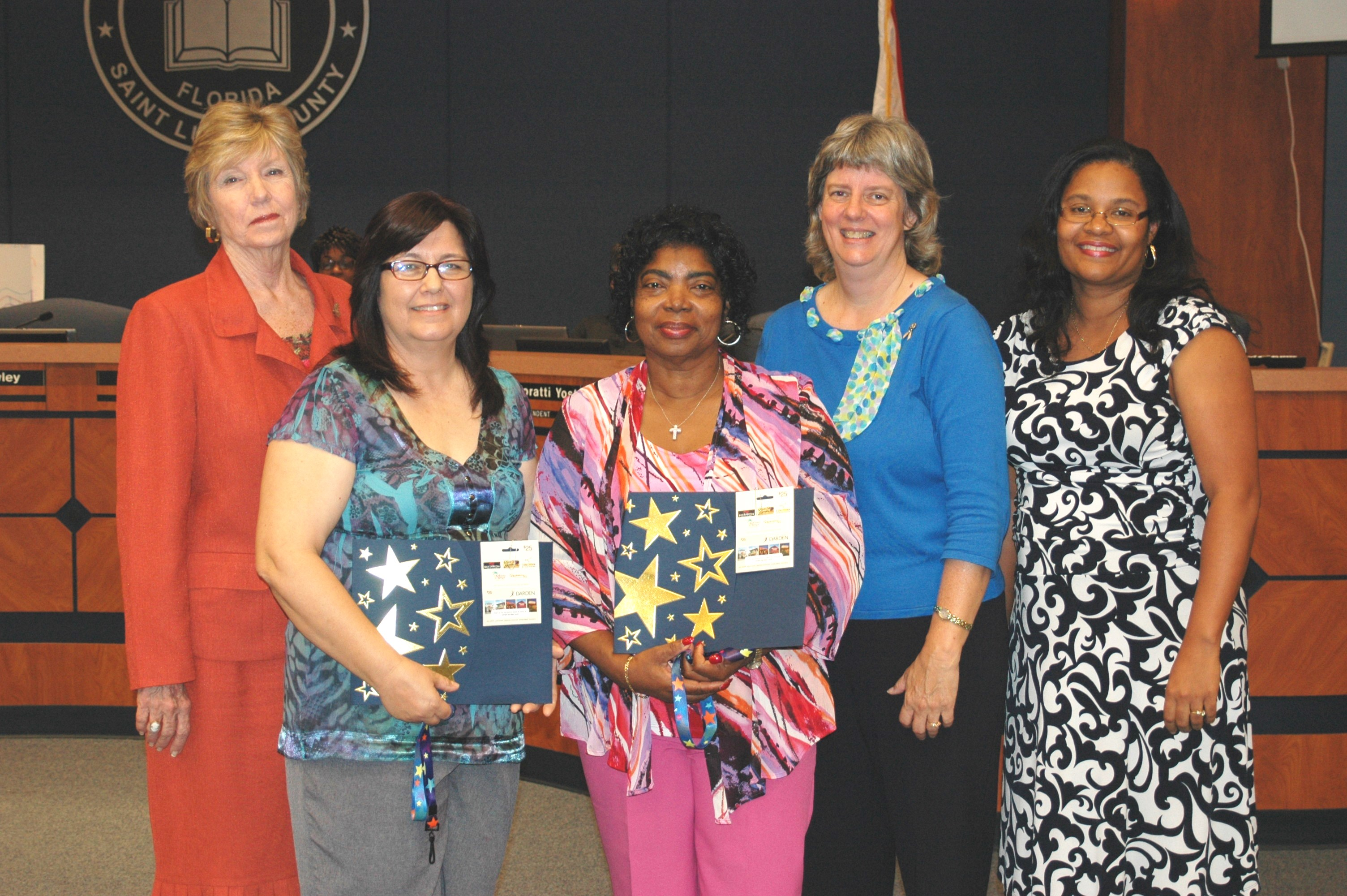Employees honored at school board meeting