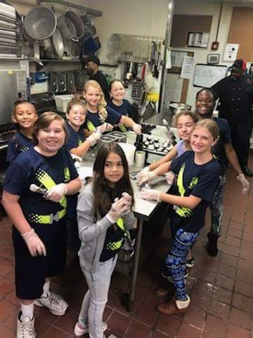 Northport Safety Patrol Steps Up to Serve Community Breakfast.